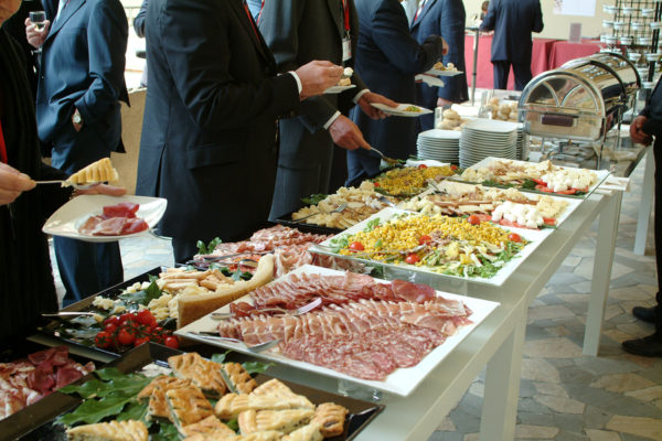 Catering food - large buffet with businessmen